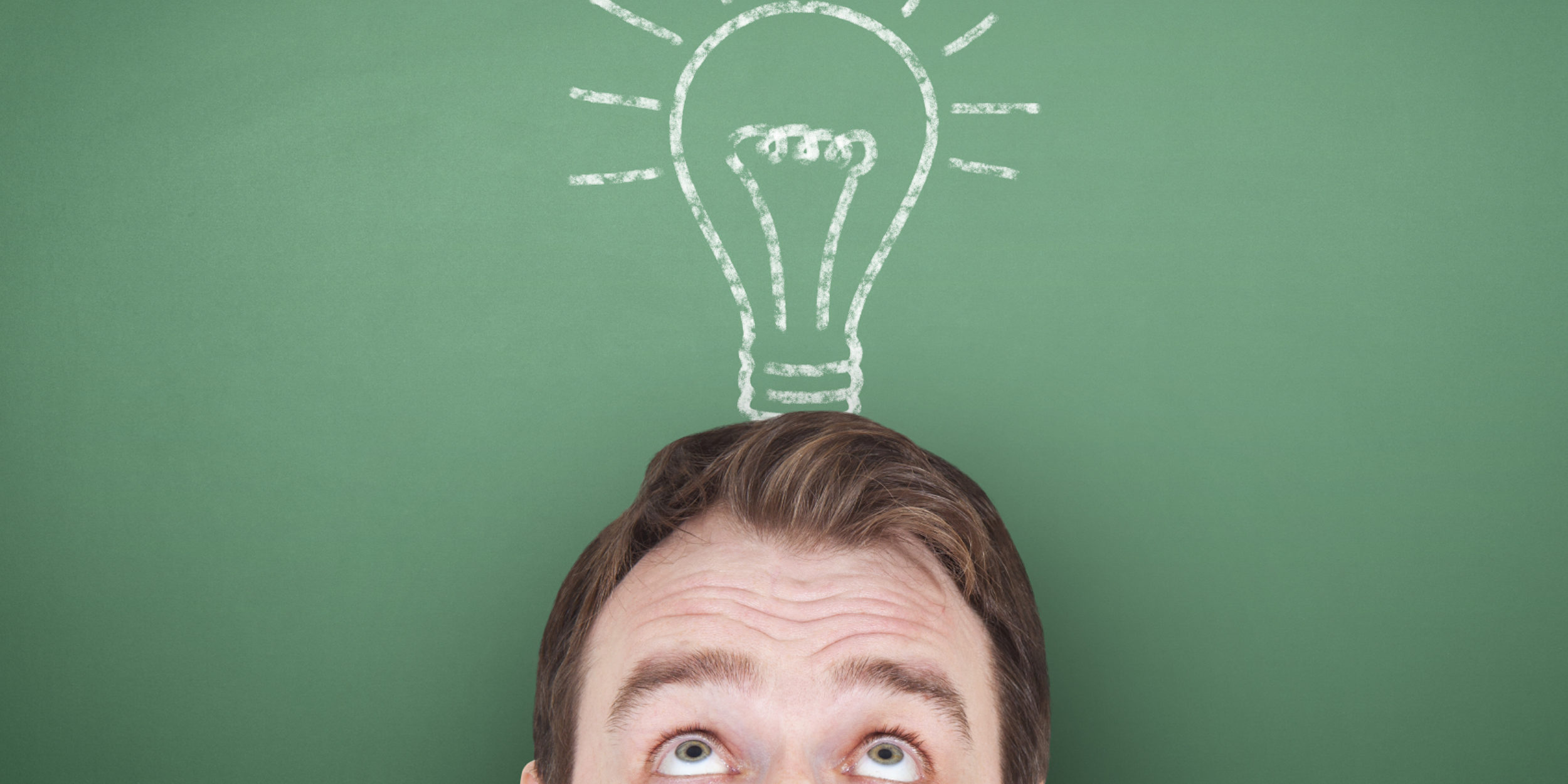man looking at drawn light bulb copy